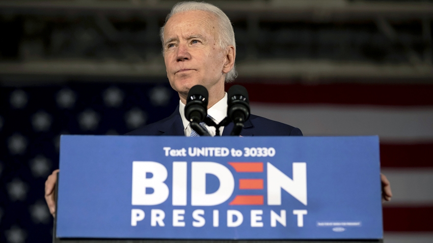 Former Vice President Joe Biden pauses during a primary-night rally