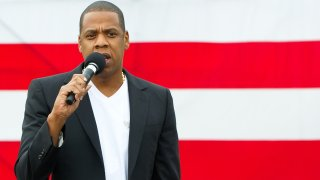 Jay-Z in front of an American flag