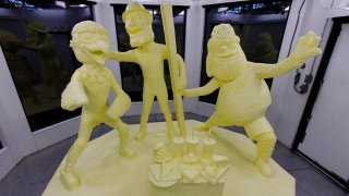 A butter sculpture depicts Gritty, Swoop and Steely McBeam, mascots for the Philadelphia Flyers and Eagles, and the Pittsburgh Steelers.