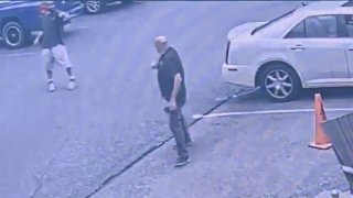 A gunman, top left, allegedly fired two gunshots at a store clerk in the parking lot outside a cigar shop in Bethlehem, Pennsylvania, over a face mask policy, Friday, July 31, 2020, police said.