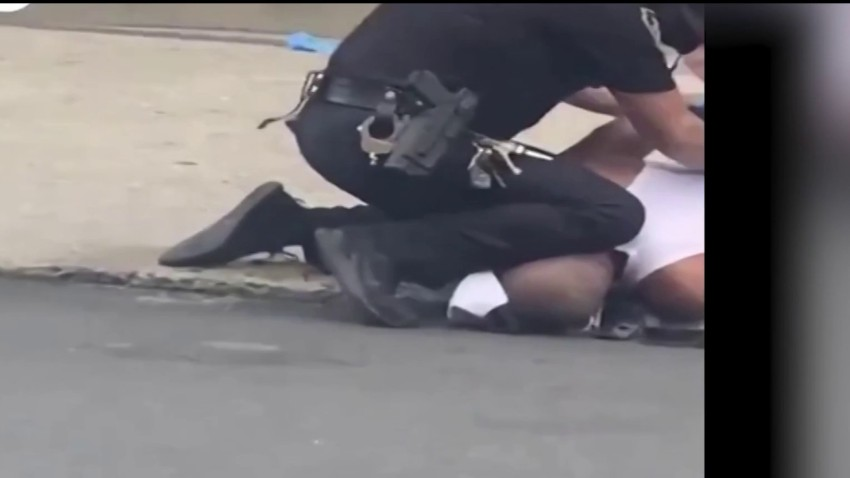 An Allentown police officer apparently kneels on a grounded man's head or neck.