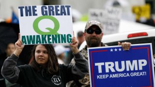 The Q-Anon conspiracy theorists hold signs during the protest at the State Capitol in Salem, Oregon, United States on May 2, 2020.