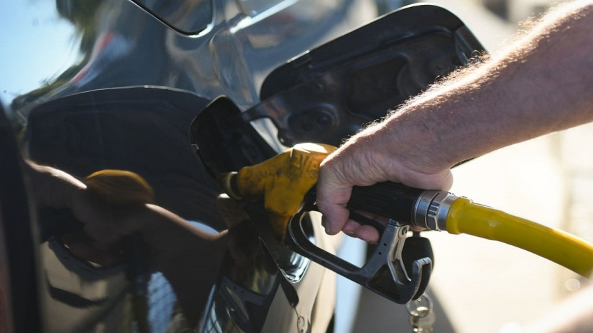A man filling up his tank.