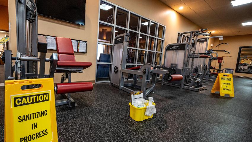 Large signs about sanitizing are posted around Golds Gym in East Northport, New York on Aug. 19, 2020, making sure everything is safe and operational for the reopening after the COVID-19 shutdown.