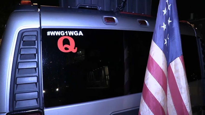 SUV with an American flag and a QAnon sticker
