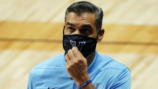 Jay Wright with a mask on