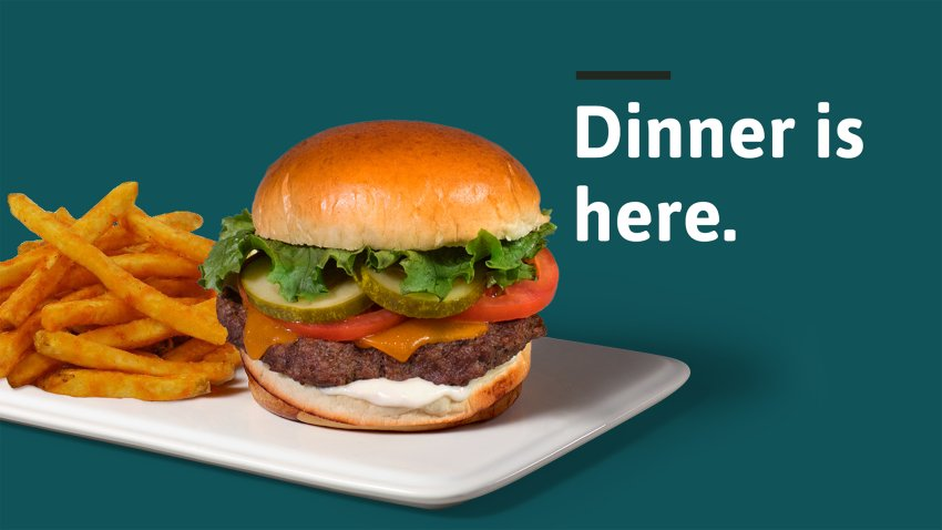 """Fries and Burger for sale at Wawa on a plate against a green background with the phrase """"Dinner Is Here"""""""