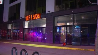 Police tape surrounds the Golf and Social Bar in Philadelphia's Fishtown neighborhood after a septuple shooting.