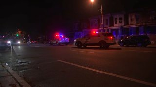 Philadelphia police vehicles block off a street in the Nicetown neighborhood, following a fatal hit-and-run