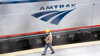 A worker is seen on the Amtrak train platform