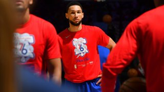 Ben Simmons in a red Sixers' warmup t-shirt