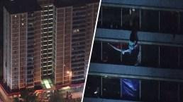 Arriesga su vida para escapar de incendio en torre de 15 pisos